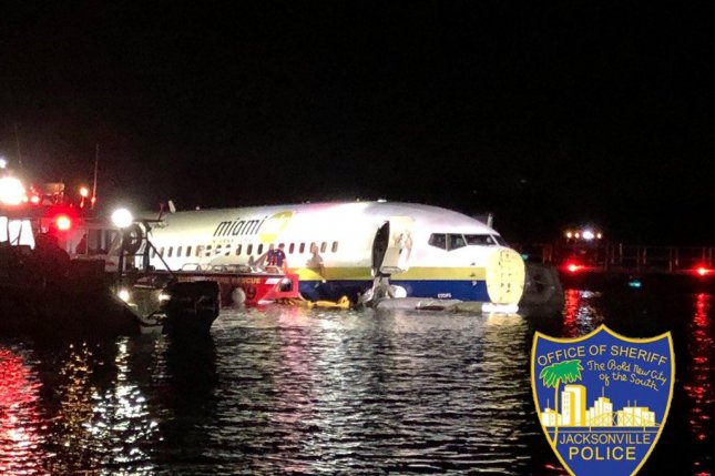 The pilots of the Boeing 737 that slid into the water at Naval Air Station in Jacksonville changed runways just before landing, NTSB officials said Sunday. Photo courtesy Jacksonville Sheriff's Office/Twitter