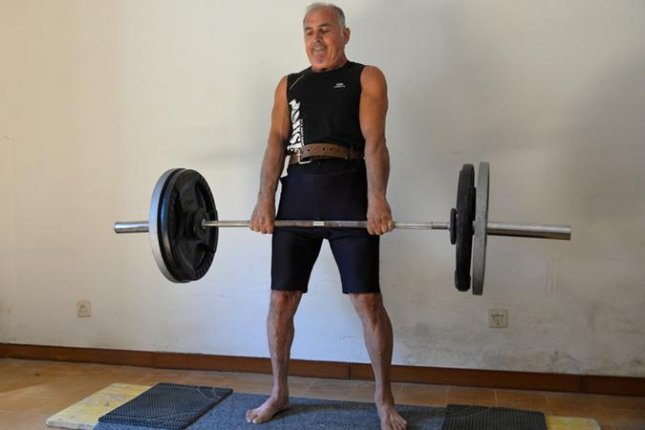 Marcello Ferri, 59, of Pesaro, Italy, broke a Guinness World Record by deadlifting a 220.46-pound weight for 6 minutes and 3 seconds. Photo courtesy of Guinness World Records