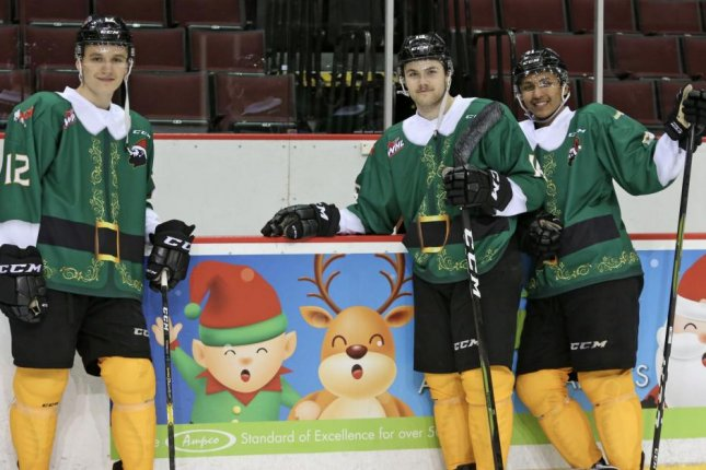 Vancouver Giants players model their Buddy the Elf jerseys prior to Saturday's game against the Victoria Royals. Photo courtesy of the Vancouver Giants/Twitter