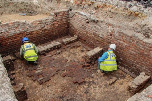Archaeologists uncovered a stage, seating, scaffolding and a pair of cellars where beer was likely sold. Researchers estimate the remains are those of the Red Lion, the first permanent playhouse in London. Photo by Archaeology South-East/UCL