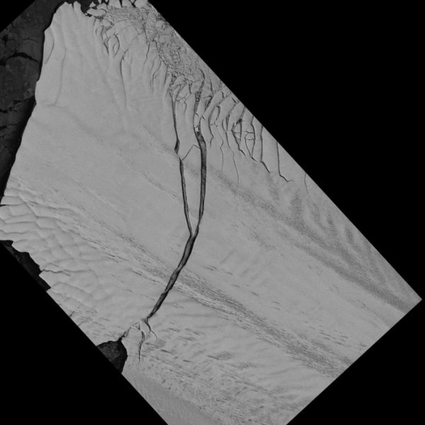 Open water shows in crack separating glacier (right) from iceberg (left). Credit: NASA