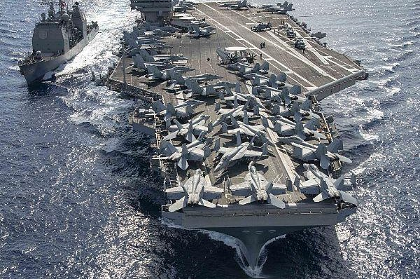 The USS Ronald Reagan seals in the Philippines Sea with the Ticonderoga-class guided-missile cruiser USS Chancellorsville before arriving Friday in Brisbane, Australia. Photo by Mass Communication Spe. 3rd Class Erwin Jacob Villavicencio Miciano/U.S. Navy