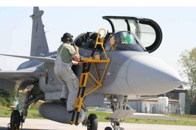 A Gripen fighter plane of the Czech air Force is prepped for flight. The Czech Republic, Belgium and Denmark will take over NATO air-policing duties over the Baltic region next week. Photo courtesy of Czech air force