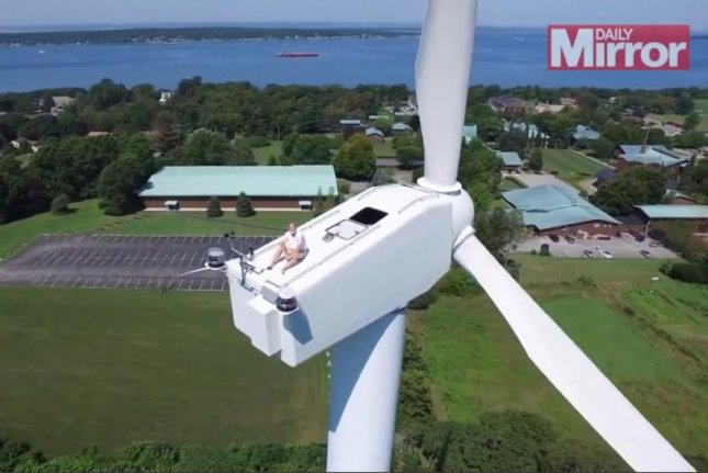 A man visiting Rhode Island decided to take drone footage of this wind turbine and discovered a man sunbathing atop the structure. JukinMedia video screenshot