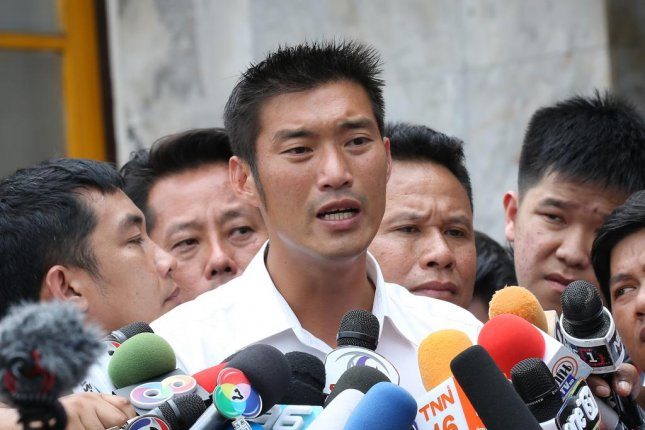 Thai Future Forward Party co-founder and leader Thanathorn Juangroongruangkit (C) talks to media after meeting with police at the Pathumwan Police Station in Bangkok, Thailand, on Saturday. Photo by EPA-EFE/Narong Sangnak