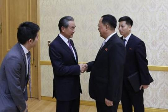 A handout photo made available Tuesday by the Ministry of Foreign Affairs of the People's Republic of China shows North Korean Foreign Minister Ri Yong-ho (C-R) shaking hands with his Chinese counterpart Wang Yi (C-L) prior to their talks at the Mansudae Assembly Hall in Pyongyang. Photo courtesy of Ministry of Foreign Affairs of the PRC/EPA-EFE