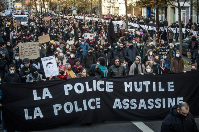 Protesters holds a banner reading 'Police Mutilates, Police Kills' during a demonstration against the newly passed controversial global security law, in Paris, France Saturday. Photo by Christophe Petit Tesson/EPA-EFE