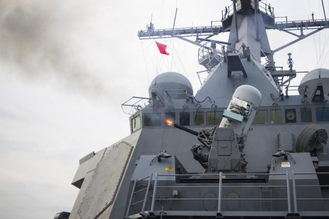 The Arleigh Burke-class guided-missile destroyer John S. McCain fires its phalanx close-in weapons system during a live-fire exercise in 2014. Photo by Ricardo R Guzman/U.S. Navy