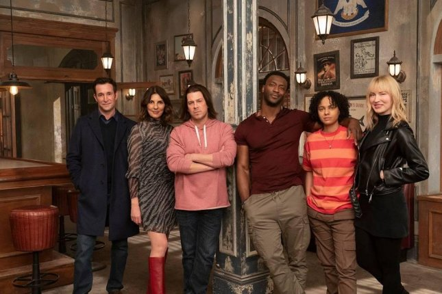 Noah Wyle (L) leads the Leverage: Redemption team, from left to right, Gina Bellman, Christian Kane, Aldis Hodge, Aleyse Shannon and Beth Riesgraf. Photo courtesy of IMDb TV