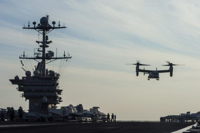 A V-22 Osprey lands on an aircraft carrier. U.S. Navy photo
