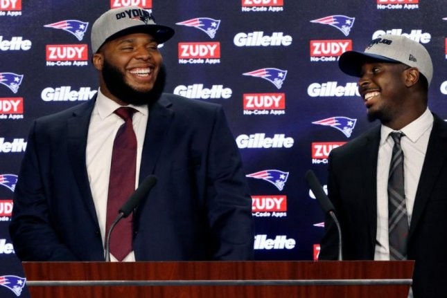 Offensive lineman Isaiah Wynn (L), the first of the New England Patriots' two first-round draft choices, has signed with the team, the Patriots announced on Friday. Photo courtesy of New England Patriots/Twitter