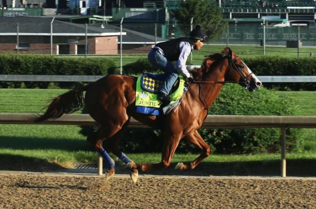 2018 Triple Crown winner Justify works out at Churchill Downs before shipping to New York for the final race in the Triple Crown series, the Belmont Stakes. Photo courtesy of Churchill Downs