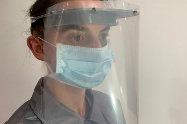 Budmen Industries, a company that makes 3D printers in Syracuse, N.Y., has converted to making face shields for medical staff. Photo courtesy of Budmen Industries