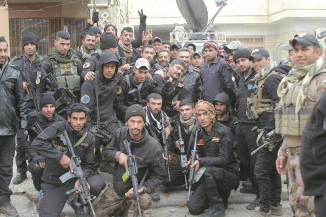 Members of the Iraqi Counter Terrorism Service gather for a picture on Sunday during a large-scale offensive to recapture the city of Mosul from the Islamic State. On Thursday, Iraqi security forces captured the town of Tel Kaif, on the northern outskirts of Mosul. Photo courtesy of Iraqi Counter Terrorism Service