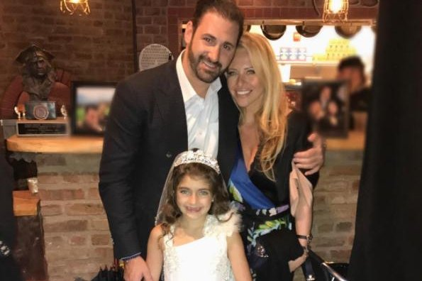 Dina Manzo and boyfriend David Cantin celebrate Real Housewives alum Teresa Giudice's daughter Audriana's first communion Saturday. The couple were bound and beaten during a robbery after they returned home from the event. Photo by Dina Manzo/Instagram