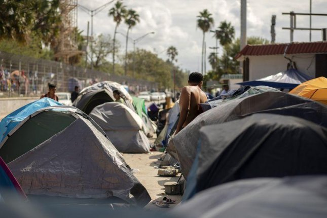 Rows of tents are clustered near the Gateway International Bridge in Matamoros, Mexico. Photo by Miguel Gutierrez Jr./The Texas Tribune