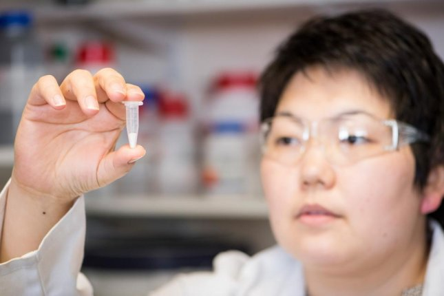 Lead researcher Asel Sartbaeva holds a sample of ensilicated protein. Powdered vaccines can be stored at room temperature for up to a year without loss of function, researchers found. Photo by the University of Bath