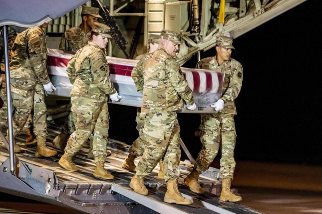 Members of the Air Force Old Guard Carry team transfer the casket of a military member killed last week in the shooting at Naval Air Station Pensacola, in Dover, Delaware, on Sunday. Photo by Scott Serio/EPA-EFE