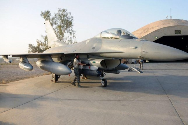 The F-16 program of the Iraqi military, aircraft like the one pictured at Balad Air Base in Iraq, is in jeopardy because of attacks by militias aligned with Iran, an Inspector General report this week says. Photo by TSgt. Caycee Cook/U.S. Air Force