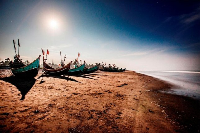 Fishing boats, such as these in Bangladesh, are often used by migrants to escape from Myanmar and Bangladesh to Malaysia and Indonesia. Over 2,000 migrants came ashore Sunday and Monday in Malaysia and Indonesia, a sign that attempted escapes from Myanmar and Bangladesh are increasing. Photo Courtesy of U.N. News Center.