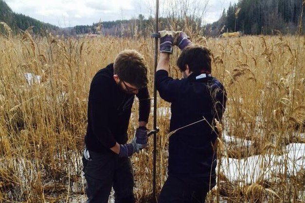 Researchers James Lea, on the left, and Francesco Muschitiello collect sediment cores from the bed of an ancient glacial lake in Sweden. The layered deposits, or glacial varves, can reveal changes in ancient melting rates. Photo by Francesco Muschitiello/Columbia University