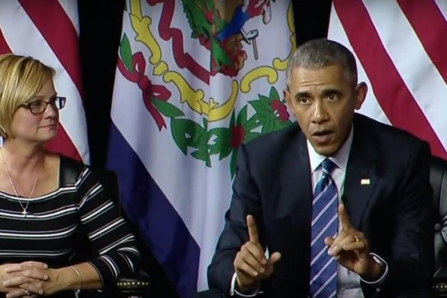 President Barack Obama attends a community forum in Charleston, W. Va., Wednesday to outline new efforts to fight opiate drug abuse -- an epidemic, officials say, that causes more than 100 Americans to die from drug overdoses daily. Obama's new efforts include focusing on prescriber training and greater treatment access. Photo by the White House / YouTube
