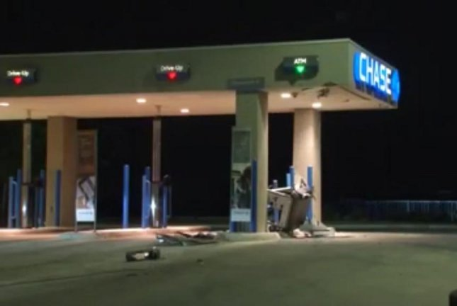 Police in San Antonio said a thief or thieves used a forklift stolen from a construction site to make off with the inner workings of an ATM from a Chase branch. Screenshot: WOAI-TV