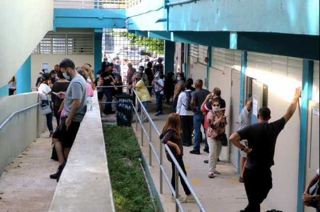 Voters wait to cast ballots at a polling station in Guaynabo, Puerto Rico, on Election Day, November 3. Photo by Jorge Muniz/EPA-EFE