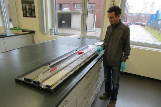 Francisco J. Rodriguez-Tovar, lead author of the new study on rapid recovery from the end-Cretaceous mass extinction event, is in Bremen, Germany, working with a core taken from the the Chicxulub impact crater. Photo courtesy of The Geological Society of America.