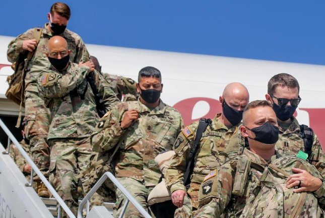 Soldiers assigned to the 101st Airborne Division's 101st Combat Aviation Brigade arrive in Germany for a nine-month rotation June 22. Photo by Alleea Oliver/U.S. Army
