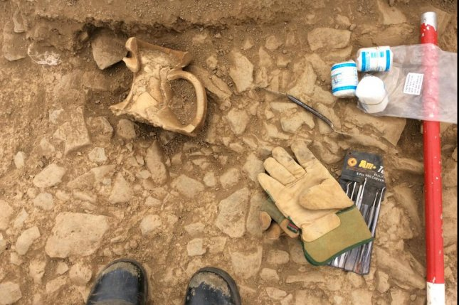 The ancient amphora, just before being removed from the excavation site. Photo by University of Exeter