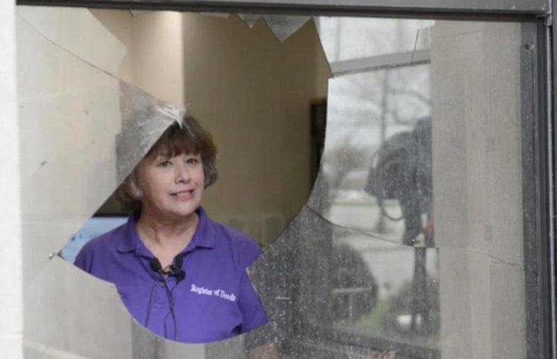A deer burst through one pane of the double-pane window outside Register of Deeds Nancy Burns' office on Monday. Screen capture/Kansas City Star