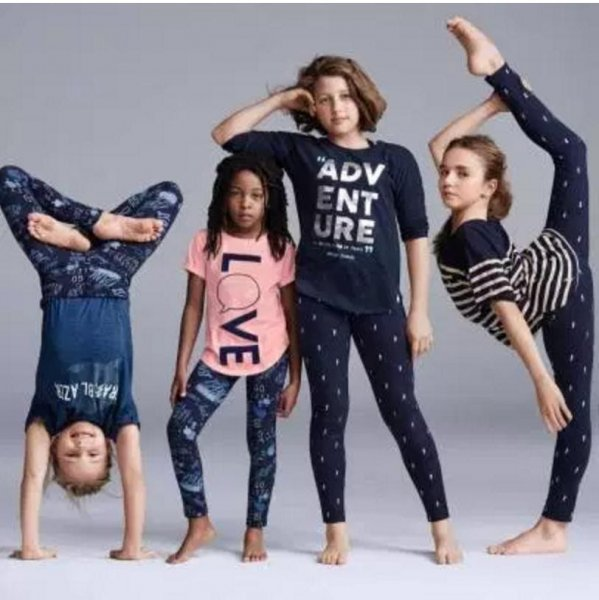 The Gap apologized after an ad for a new line of kid's clothing featured an image that offended some: A white young girl with her arm resting on the head of a young black girl. The image was replaced but the ad campaign will continue, the company said. Photo courtesy The Gap