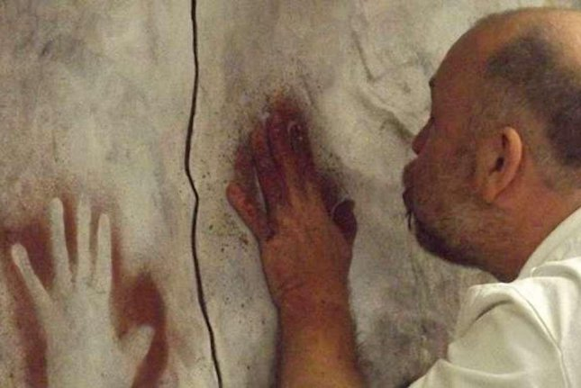 Researchers built a model cave wall to test their ability to determine the sex of hand stencil artists in the lab. Photo by University of Liverpool
