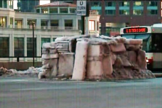 David Sudler built this downtown Chicago igloo from ice sheets he cleared from nearby sidewalks. WGN-TV video screenshot