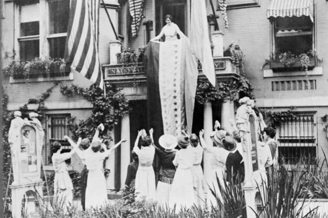 Alice Paul unfurls a banner from the balcony of the National Women's Party headquarters on August 17, 1920 in Washington, D.C. The banner shows a star for each state which ratified the 19th Amendment, giving women the right to vote. The official certification that Tennessee had become the 36th state to ratify the amendment was taken to the office Secretary of State Colby on August 20, 1920. File photo by UPI.