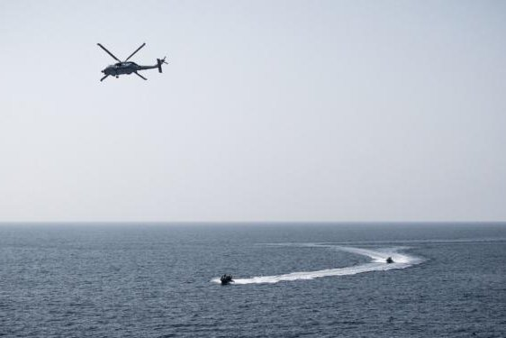 A MH-60R Seahawk flies off the USS Jason Dunham practicing engaging fast-attack boats during an exercise. Photo by Petty Officer 3rd Class Jonathan Clay/USS Jason Dunham (DDG109)