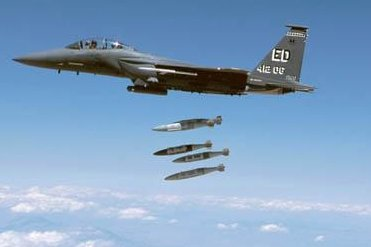Several 500-pound bombs equipped with Joint Direct Attack Munition Global Positioning System guidance kits are released from an F-15 aircraft during testing. Photo courtesy Boeing