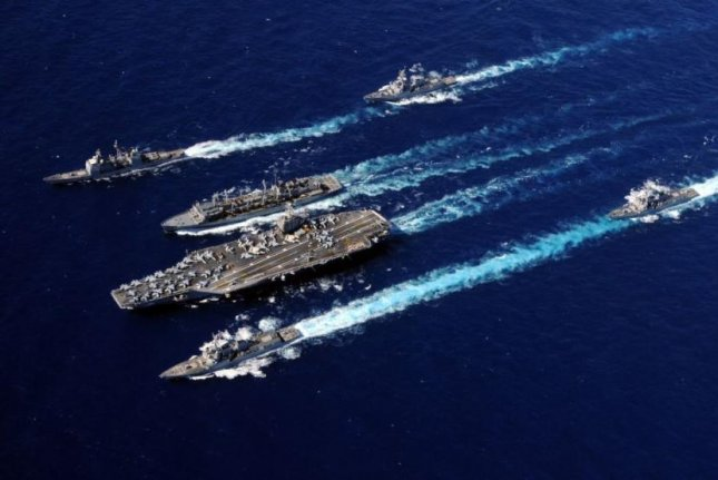 Ships of the U.S. Navy's Abraham Lincoln Carrier Strike Group departed Naval Station Norfolk, Va., on Monday to participate in Composite Training Unit Exercises. Photo by MCS3 Stephen Doyle/U.S. Navy/UPI