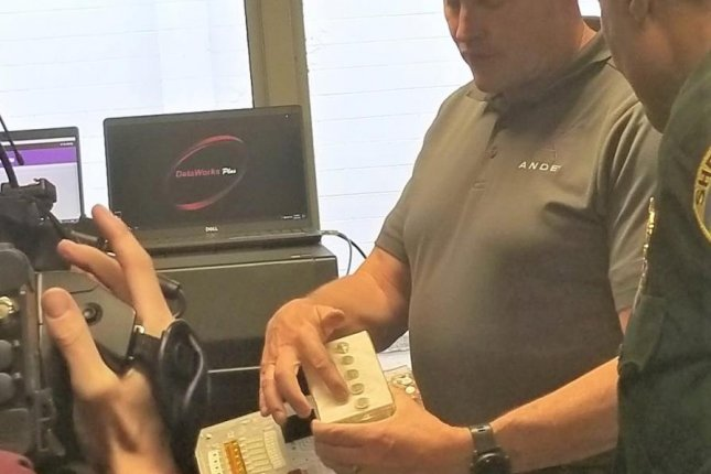 Personnel demonstrate a DNA testing kit in Tallahassee, Fla., on Wednesday for FBI's new Rapid DNA testing system pilot program. Photo courtesy of the Florida Department of Law Enforcement