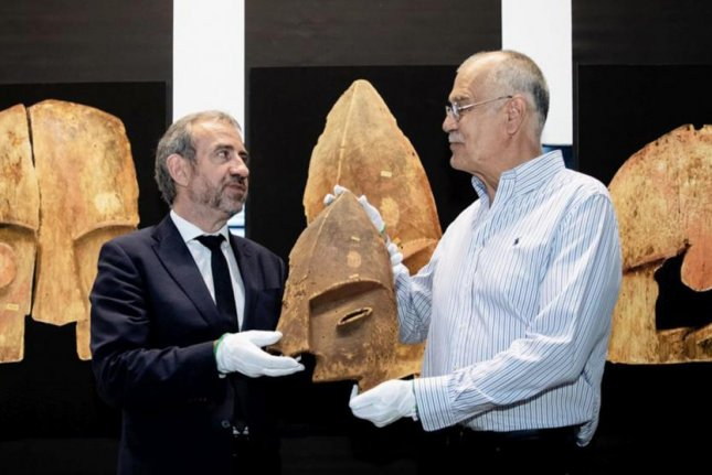 Hermann Parzinger, president of the Prussian Cultural Heritage Foundation, exchanges an artifact with John Johnson, vice president the Chugach Alaska Corporation. Photo courtesy of the Prussian Cultural Heritage Foundation