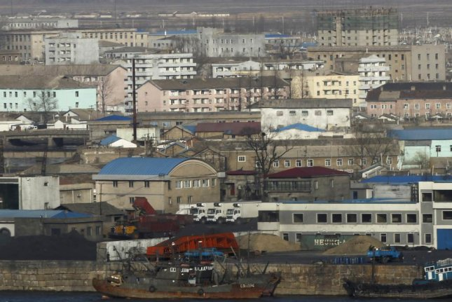 A general view of Sinuiju, North Korea, taken from across the Yalu River from the Chinese city of Dandong, Liaoning Province, China, April 6, 2013. Photo by How Hwee Young/EPA