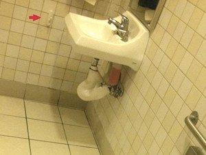 Cops say man taped people in bathroom