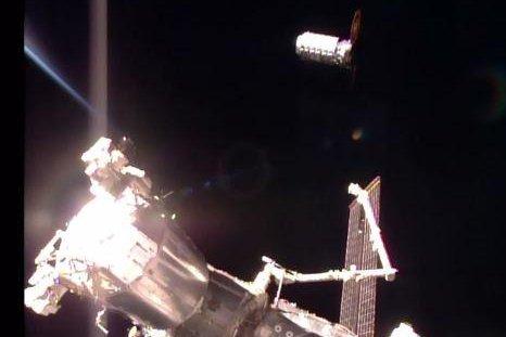 The Orbital ATK Cygnus cargo craft S.S. John Glenn (upper right) arrives near the International Space Station. Astronauts used the Canadarm2 to grab the resupply ship Saturday. Photo by NASA TV
