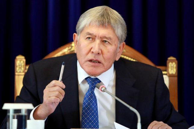 Former Kyrgyz President Almazbek Atambayev, pictured at a 2017 news conference, faces a murder-related charge for the death of a soldier. File Photo by Igor Kovalenko/EPA-EFE