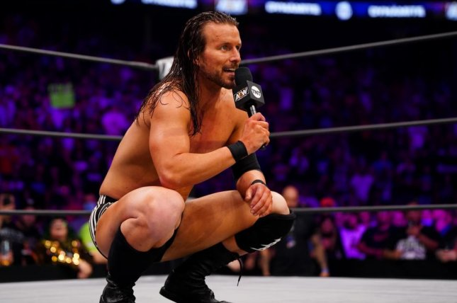 Adam Cole speaks to AEW fans on Dynamite. He is teaming up with The Young Bucks to face Jurassic Express and Christian Cage on the Friday edition of Grand Slam. Photo courtesy of AEW