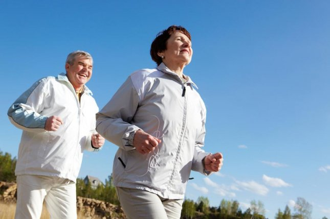 Physical activity and a healthier diet may help prevent the formation of plaques and tangles in the brain linked to Alzheimer's disease, UCLA researchers say. Photo by Pressmaster/Shutterstock