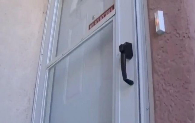 Police in Colorado issued an apology to an innocent family and their five children after they accidentally raided their home in search of a methamphetamine dealer. Authorities offered to have the damaged door, windows and carpet replaced. Screen capture/CBS 4 Denver/AOL