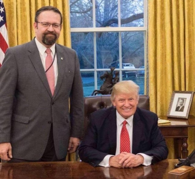 Sebastian Gorka (L), a former Breitbart national security editor who works as President Donald Trump's national security aide, will soon leave his White House role for a position elsewhere, possibly in a federal agency or within the administration. Photo courtesy of White House