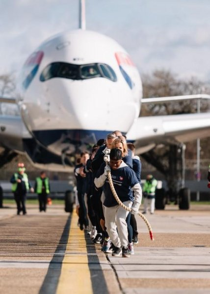 A team of sports celebrities and British Airways employees pulled a 201.6-ton plane a distance of 328 feet to break a Guinness World Record. Photo courtesy of Stuart Bailey/British Airways